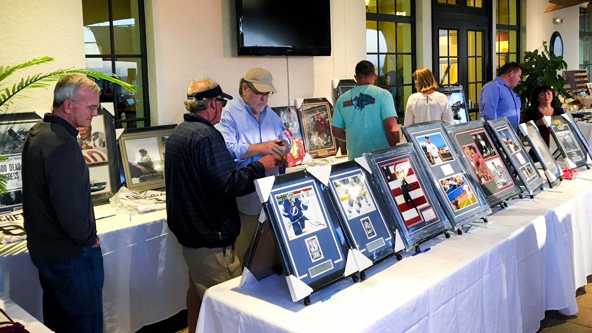 People looking at items at an event run by SociallyFunded