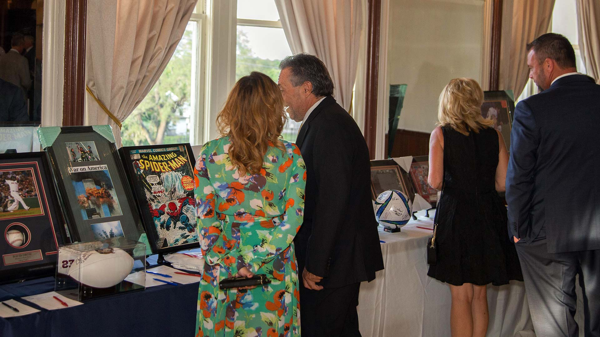 Two people looking at items at an event run by SociallyFunded