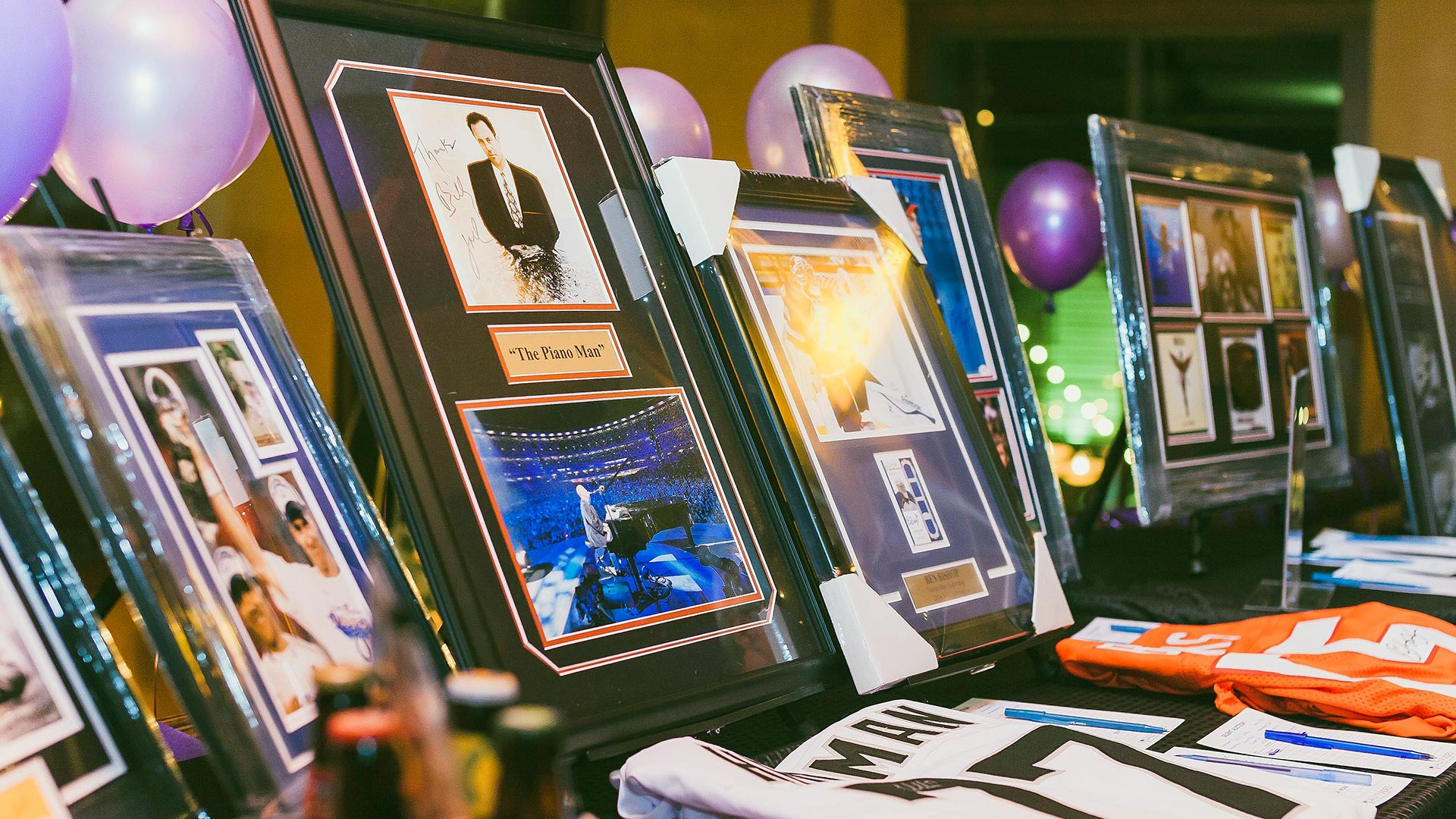 Auction items at an event run by SociallyFunded